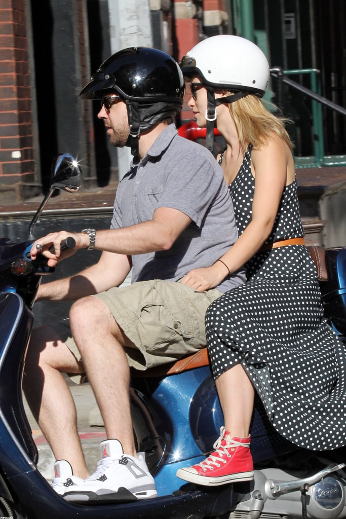 """Jason Sudeikis took the helm of his Vespa yesterday in NYC, with girlfriend Olivia Wilde holding on tight. She's been jetting back and forth between LA, London, and NYC in recent weeks while working on two films. She stars with Chris Hemsworth in Ron Howard's Rush, and shares the big screen with Jim Carrey and Steve Carell in The Incredible Burt Wonderstone.  As for Jason, it seems his uncertain future on SNL will be decided in the upcoming months. According to the show's producer, Lorne Michaels, no final decisions have been made about next season's cast. Lorne recently talked about Jason and Andy Samberg's rumored departure from SNL, saying, """"I've had a rule since the second season, which is to not make any decisions in June. We'll see in July."""" One key player who won't be back in the Fall is Kristen Wiig. After seven years and many memorable Kristen Wiig characters, she ended her run on this year's season finale."""