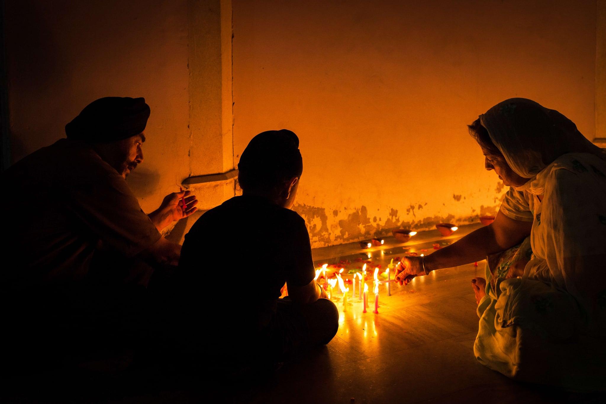 PATIALA, PUNJAB, INDIA - 2014/10/23: Family celebrating Diwali festival night, also Bandi Chhor Divas celebration for the Sikh religion followers at the Gurdwara Dukh Nivaran Sahib in Patiala, Punjab, India. (Photo by Marji Lang/LightRocket via Getty Images)