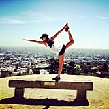 Lea Michele stretched out with some yoga moves during a sunny hike in LA. Source: Instagram user msleamichele