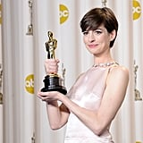 Anne Hathaway showed off her Oscar for best supporting actress.