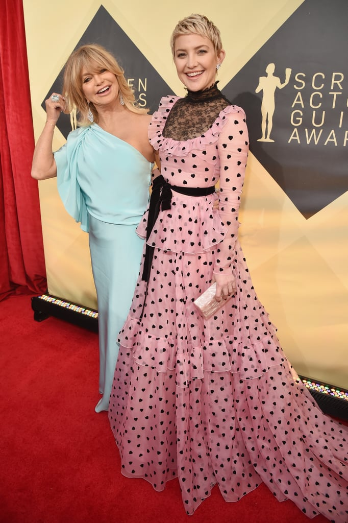 "Goldie Hawn and Kate Hudson brought their signature charm and bubbly personalities to the SAG Awards red carpet on Sunday. The duo walked hand in hand before stopping to take photos with Dakota Fanning and for an interview with E!'s Giuliana Rancic — which quickly turned into a sweet and silly show of its own. The host first asked Kate about the biggest lesson she's learned from her mom, to which Kate replied, ""To be compassionate; I have a lot of fight in me by nature,"" adding, ""And that family is everything."" When asked the same question, Goldie quipped, ""Absolutely nothing!"" which was met with laughter by the group, including the cameramen. Goldie then said of Kate, ""She is tougher than I was, [and] she's extremely truthful.""       Related:                                                                                                           Kurt Russell and Goldie Hawn's Modern Family Is Absolutely Golden               Kate and Goldie have been spending some cute quality time together recently; just last week, they stepped out together for Stella McCartney's Autumn Collection launch, and Kate shared adorable video of her mom cutting a rug to a performance by Stella's dad, Paul. Keep reading to see all the photos from Goldie and Kate's night at the SAG Awards."