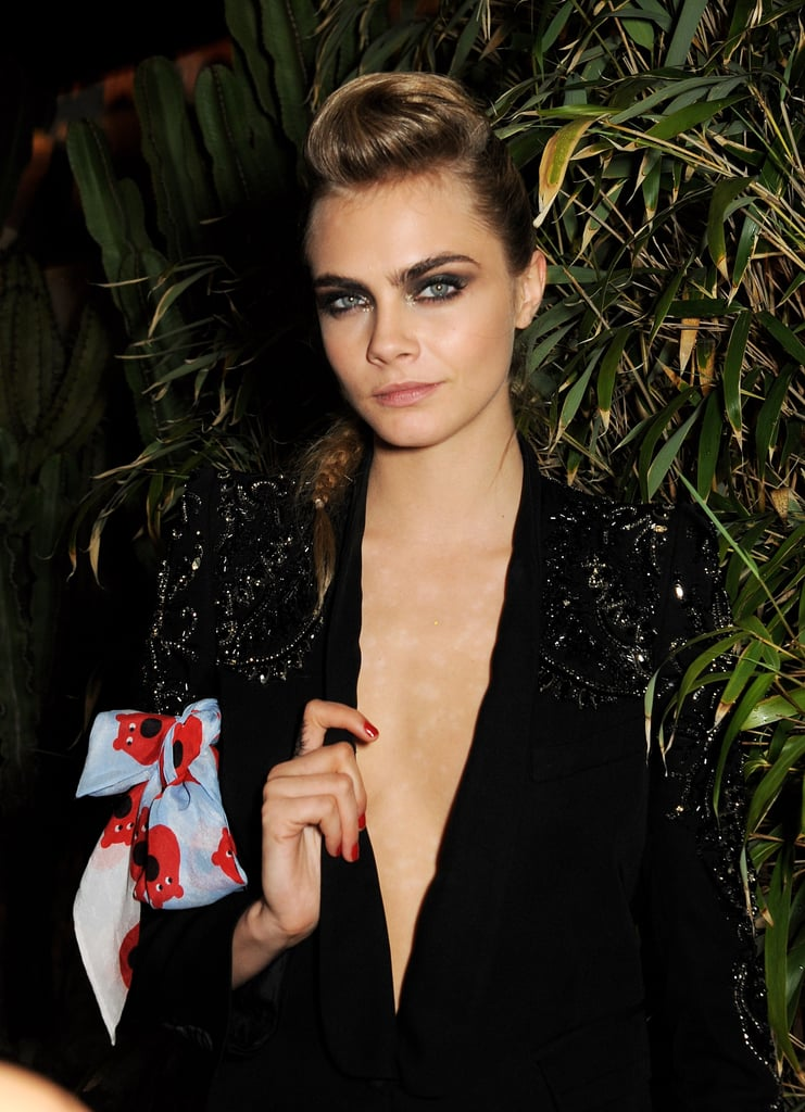 The rock-star theme was apparent in Cara Delevingne's beauty look for the Calvin Klein fete. She wore a pompadour-and-braid combination with an exaggerated smoky eye.