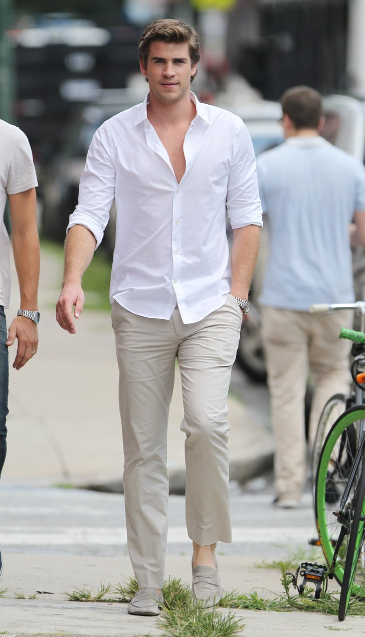 Liam Hemsworth Wore A White Collared Shirt And Khakis On