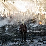 A protester wearing a gas mask stood among charred garbage as the group clashed with policemen.