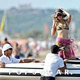 Paris Hilton approached the beach on a smaller boat.