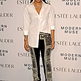 Monique Péan was perfectly undone in a button-down and embroidered trousers at the Estée Lauder event.