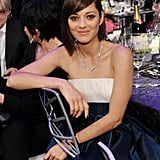 Marion Cotillard lounged at her table.