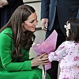 Kate shared a sweet moment with a little girl bearing flowers during a stop on her Australian tour in April 2014.