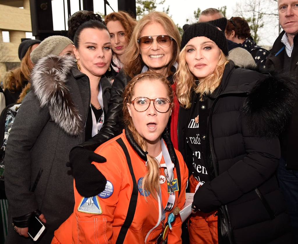 History was made on Saturday when hundreds of thousands of people around the country came together for the Women's Marches. While several stars showed their support on Instagram, a handful of other celebrities rallied together and hit the streets. John Legend, Chelsea Handler, and Charlize Theron were at the center of the action in Park City, UT, while Katy Perry, Chrissy Teigen, and Jason Sudeikis joined forces in Washington DC. Cher and Madonna even put their rumored feud aside and Ashley Judd fired up the crowd with a powerful speech. Read on to see all the stars who popped up at the marches.
