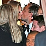 Leonardo DiCaprio got a sweet kiss from his girlfriend, Toni Garrn, outside CAA's post-Golden Globes bash in LA.