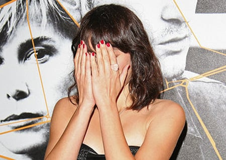 Guess Which Female Celebrity Was Feeling Camera Shy in Paris and Hide Behind Her Berry Mani?