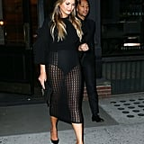 Chrissy Decided to Wear a Black Caged Skirt and Ruffled Top For Date Night With John Legend