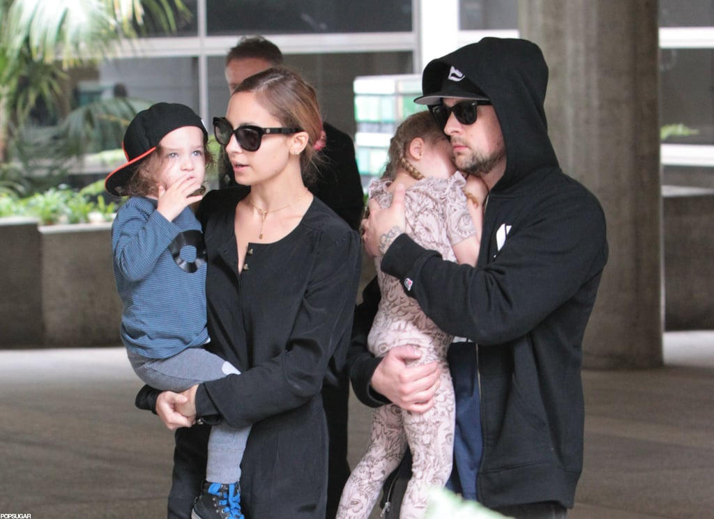 Joel Madden cradled Harlow Madden as they walked through LAX.