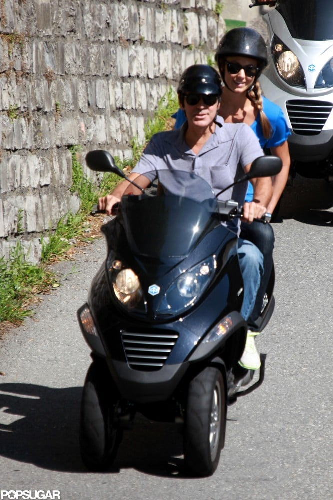 Both George Clooney and Stacy Keibler donned black sunglasses and helmets for a ride around Switzerland in July.