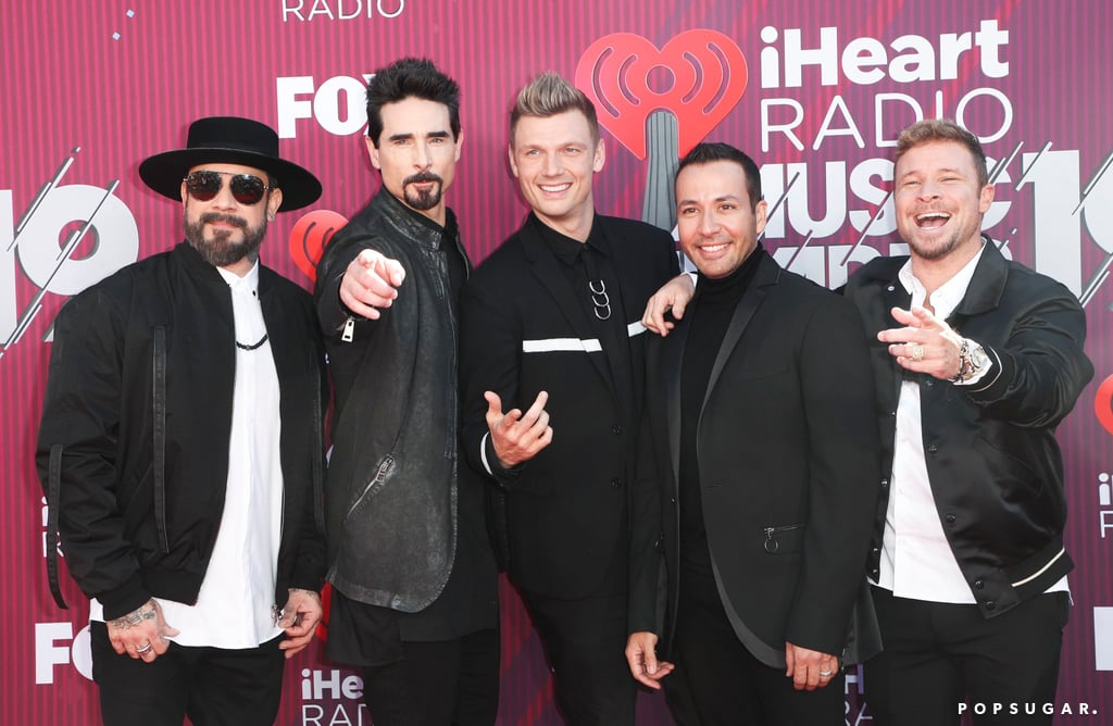 The Backstreet Boys are in full force at the iHeartRadio Music Awards! On Thursday, the band took a break from rehearsing for their upcoming DNA tour to attend the award show. The group, who is set to perform during the show, looked incredibly dapper in matching black ensembles as they walked the red carpet and smiled for photographers.  The guys have been keeping busy lately! In addition to releasing their ninth album DNA earlier this year, they were recently nominated for a Grammy. In February, they had a group date night with their beautiful wives as they attended the ceremony. See more of their fun-filled night at the iHeartRadio Music Awards ahead!