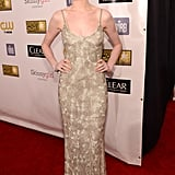 Anne Hathaway posed in a metallic gown.