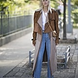 We know this jacket might not be suede, but we love it just the same. Layering one jacket (that has fringe on it by the way) over a longer coat and basic white tee, with jeans and boots, is definitely a nod to Phoebe and her boho-chic ensembles.
