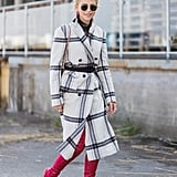 Cinch a Plaid Coat With a Belt and Complete With High Boots