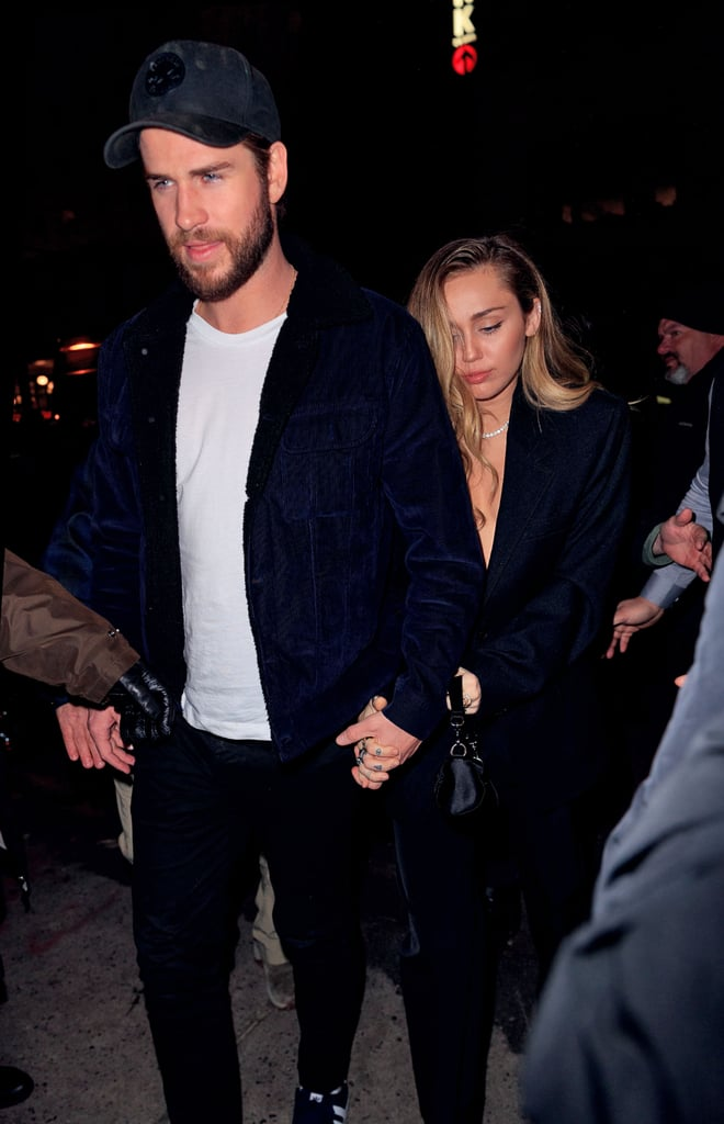 "Miley Cyrus and Liam Hemwsworth are doing date night right! The couple stepped out hand-in-hand after Miley's powerhouse Saturday Night Live performances on Dec. 15 to attend the show's afterparty. Naturally, the 26-year-old singer chose the ideal outfit for a night out with her fiancé.  Miley opted for a plunging black blazer and matching trousers as she arrived at the party with Liam. While she went with a monochromatic pantsuit, the look was anything but simple when paired with her sparkling jewellery. It looks like Miley's especially partial to all-black outfits these days — we've seen similarly stylish looks from her ""Nothing Breaks Like the Heart"" promo tour. Check out more snaps of her chic ensemble ahead.       Related:                                                                                                           Miley Cyrus Found a Go-Go Boot For Modern-Day Hippies"