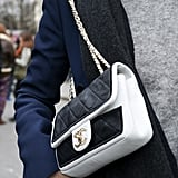 How gorgeous is this black-and-white Chanel bag? We also love the gold collar necklace peaking from the top as well . . .