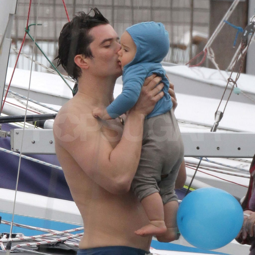 Orlando Bloom shirtless with baby Flynn.