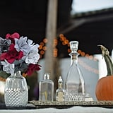 A small pumpkin and potions bottles are a pretty and simple way to play up the theme.
