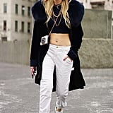 Play up a theme like Chiara Ferragni and give off '80s hip hop vibes with layered gold chains, sneakers, and cropped khaki pants.
