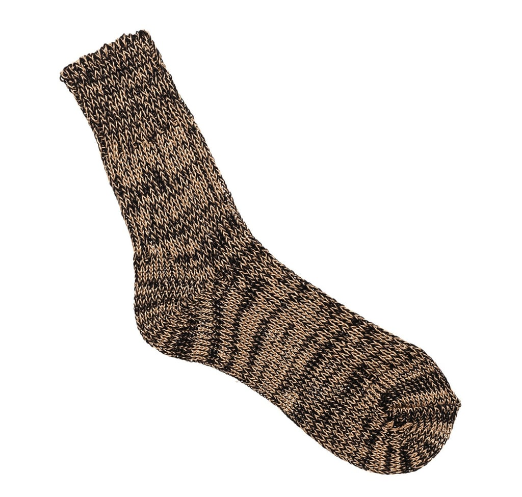 The blended knit texture of this Marni sock ($60) instantly makes us think of cozy cabin-geared outfits and warm fireside layers.