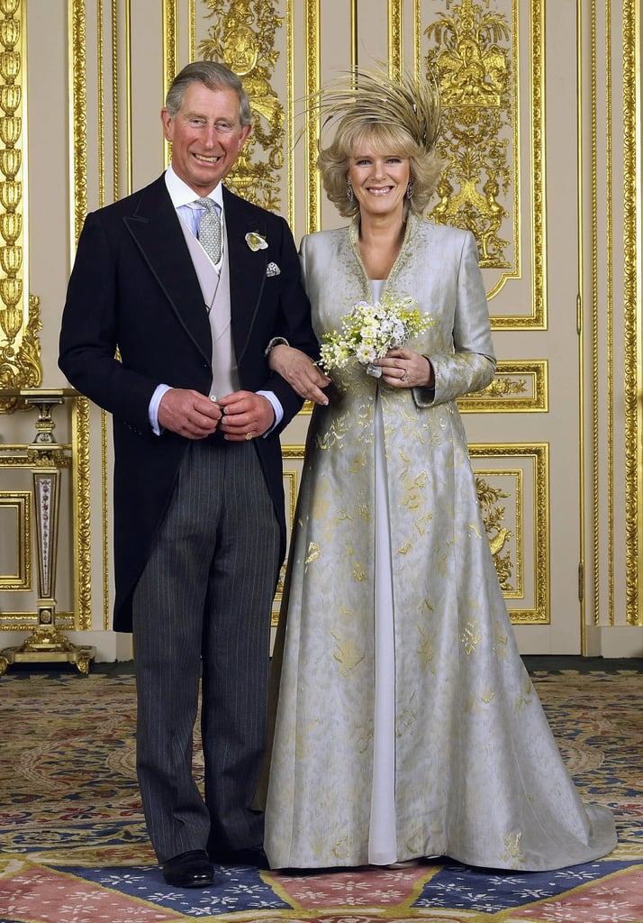 Both Prince Charles and Camilla Parker Bowles had their wedding day ensembles created by Robinson Valentine. She also wore a head piece by Phillip Treacey.
