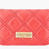 Already employed or not, they'll need a place to store business cards eventually. A bold shade like this Marc Jacobs coral option ($250) will be easy to find in a bag when they need to share info.