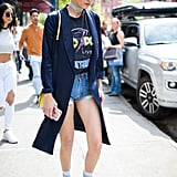 Gigi Wore Her Cutoffs and Duster Combo With a Graphic T-Shirt, High-Tops, and a Choker