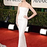 Anne Hathaway stole the red carpet in her sleek white gown.