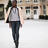A cream -colored blazer is smart over a striped tee and jeans.