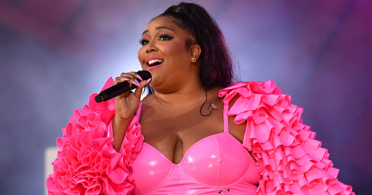 Lizzo Challenged Barbie to Top Her Hot-Pink Lace-Up Catsuit, and It's Going to Be Tough.jpg