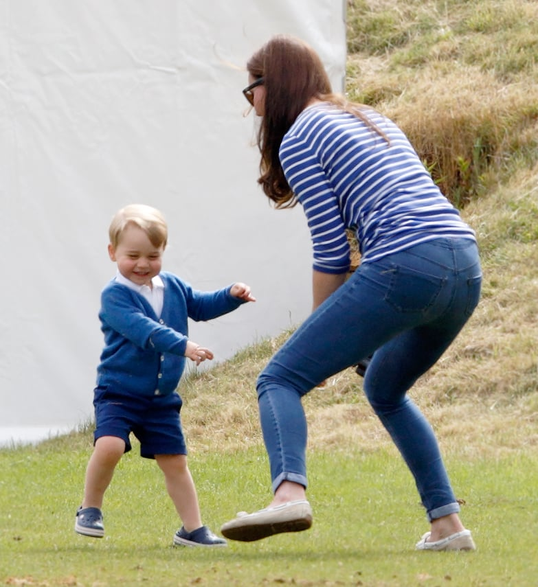 Prince George stole the spotlight from the sidelines! On Sunday, June 14, Kate Middleton treated George to a sunny day at the Gigaset Charity Polo Match in Tetbury, England. Prince William participated in the game but took time out to chat with his family, including dad Prince Charles. At one point, he leaned over to talk with George as Kate held the little guy. The cutest moments came when Kate and George ventured off from the crowd to watch the action. Kate lit up with a smile as she held George in her arms. He didn't sit down for long, though, and Kate couldn't help but laugh while watching him play.  Their outing came just one day after George made his debut on the Buckingham Palace balcony during the Trooping the Colour festivities in London. The event marked Kate's first official appearance since giving birth to Princess Charlotte on May 2. Read on to see the family's Sunday together, then look back at George's cutest pictures.