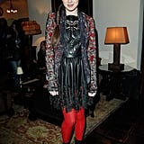 Hailee's bright tights added a pop of color to her ensemble.