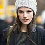 Pair your Winter cap with some heavy eyeliner and glossy lips for a fully balanced (and beautiful) look like model Kayley Chabot. Source: Le 21ème   Adam Katz Sinding