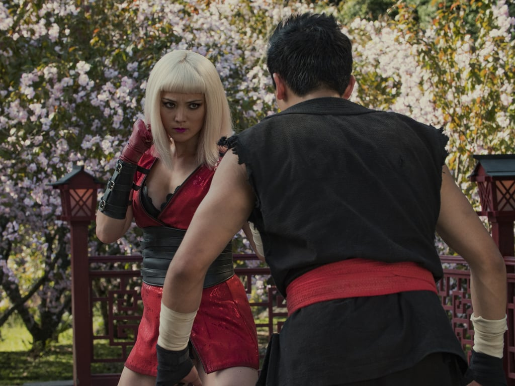 Pom Klementieff (Avengers: Endgame) faces off against an opponent in what looks like the inside of a Mortal Kombat-style video game.