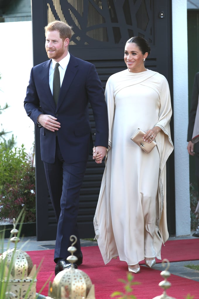 The Duke and Duchess of Sussex ended a very busy day in Morocco on Sunday as they attended a banquet at the home of the British ambassador to Morocco, Thomas Reilly, and his wife, Leah. The event marked the halfway point of their short tour of the country, and it was the perfect excuse to celebrate and debut some glamorous outfits. Meghan was simply stunning in a Dior gown, while Harry looked dapper in a navy suit. Arriving hand-in-hand, the expectant parents looked relaxed and happy, and as loved-up as ever. They were greeted by the ambassador's young daughters, who gave Meghan gifts of flowers. They they made their way into the dinner, which offered an opportunity for them both to meet a group of inspirational Moroccans, including young leaders, athletes, business leaders, and entrepreneurs. Keep reading to see all the photos of this very royal night out.