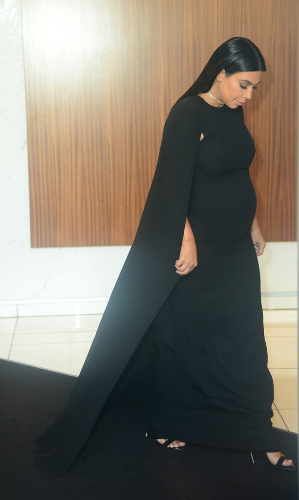 Kim's Autumn 2015 Valentino cape dress looked lovely paired with a pair of black sandals and a simple statement choker.