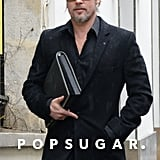 Brad Pitt walked around Paris carrying a black folder.