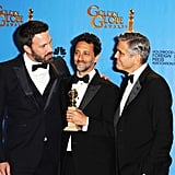 Ben Affleck met up with his producing partners Grant Heslov and George Clooney in the press room at the Golden Globes.