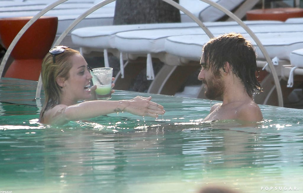 Bikini-Clad Miley Cyrus Lets Loose With a Male Companion