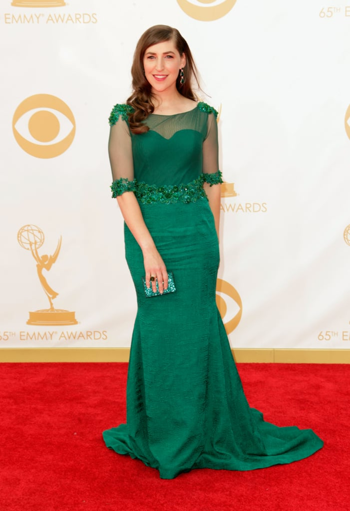 Mayim Bialik glowed in an emerald green Oliver Tolentino Couture gown, with sheer, elbow-length sleeves.