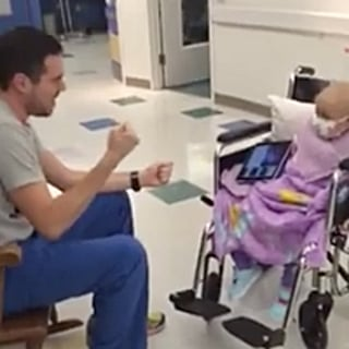 Male Nursing Singing to Little Girl With Cancer