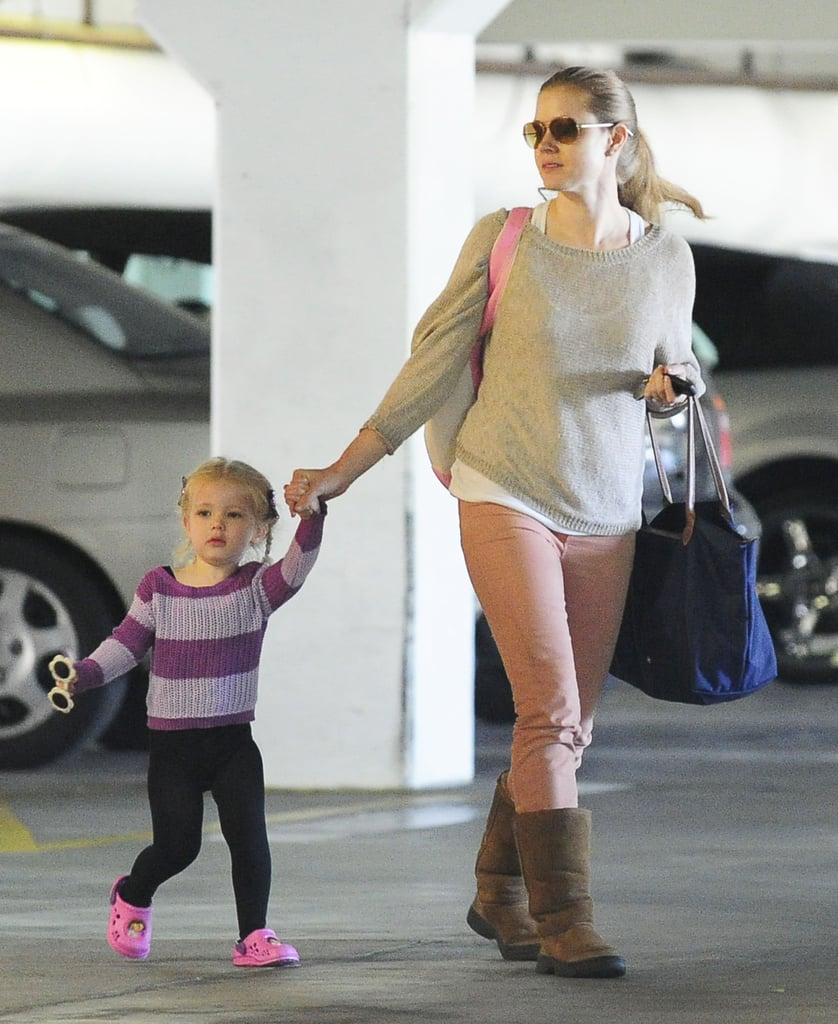Amy Adams walked with her daughter, Aviana.