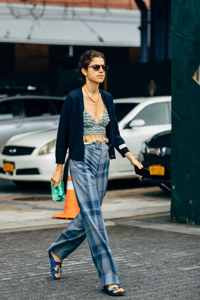 "Let your cardigan play ""hush-hush"" to a wild, eccentric crop top that bares your belly. To keep things as modest as possible down below, opt for some plaid pants."