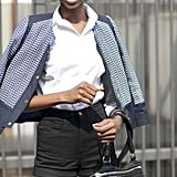 High-waisted shorts look chic with a crisp blouse and tailored jacket.
