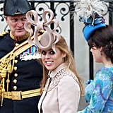 At the wedding of Prince William and Kate Middleton in 2011, wearing the hat that launched a thousand memes.