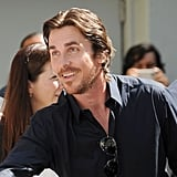 Christian Bale looked happy to attend Christopher Nolan's hand and footprint ceremony in LA.